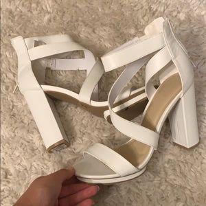 Steeply white heel.